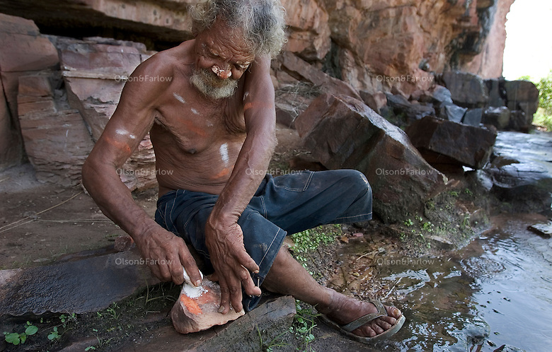 Old aborigine crawls up into the rocks outside Wyndham to perform rain ceremony.