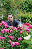 Troy Scott Smith dead heading Roses