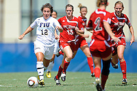 26 September 2010:  FIU's Kelly Ann Hutchinson (12) advances the ball in the second half as the FIU Golden Panthers defeated the Arkansas State Red Wolves, 1-0 in double overtime, at University Park Stadium in Miami, Florida.