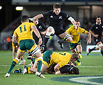 Richie McCaw jumps as Dan Carter is tackled. All Blacks beat Australia 22-0. Eden Park, Auckland. 25 August 2012. Photo: Marc Weakley