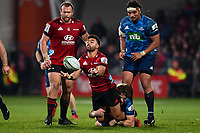 11th July 2020, Christchurch, New Zealand;  Richie Mo'unga of the Crusaders passes the ball in the tackle of  Beauden Barrett of the Blues during the Super Rugby Aotearoa, Crusaders versus Blues, at Orangetheory Stadium, Christchurch