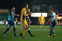 Matthew Bloomfield of Wycombe Wanderers questions the referee during the Sky Bet League 2 match between Newport County and Wycombe Wanderers at Rodney Parade, Newport, Wales on 22 November 2016. Photo by Mark  Hawkins.
