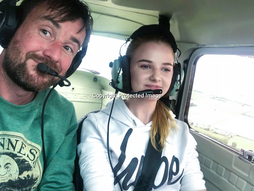 "15/08/18<br /> <br /> ***Video:   https://youtu.be/XDNa_lycFgw ****<br /> <br /> Will Flanagan and Amy Boulton at the controls before hitting the balloon.<br /> <br /> A fourteen-year-old girl on her first ever flying lesson had the fright of her life when the plane hit a gas-filled balloon yesterday. <br /> Amy Boulton screamed as the Cessna 152 collided with a bright pink balloon shaped as the number 2 as it flew at 1000 ft above a Nottinghamshire airfield at 100mph.<br /> <br /> Instructor Will Flanagan said: ""This was Amy's first flight. She had been at the controls but I was flying in to land at Gamston when I suddenly saw it - I thought it was a bird at first. It could've been a big problem if it had wrapped around the propeller. But thankfully it didn't cause any damage and we landed safely. It certainly gave Amy a shock.""<br />  <br /> All Rights Reserved: F Stop Press Ltd. +44(0)1335 344240  www.fstoppress.com www.rkpphotography.co.uk"