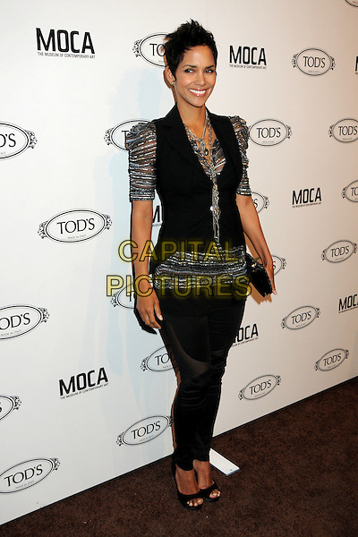 HALLE BERRY  .TOD's Beverly Hills Boutique Launch Celebration held at TOD's Boutique, Beverly Hills, California, USA, .15th April 2010..full length silver grey gray sheer puff sleeve top waistcoat black vest trousers open toe shoes clutch bag necklace sheer striped shiny leggings jeggings smiling .CAP/ADM/BP.©Byron Purvis/AdMedia/Capital Pictures.