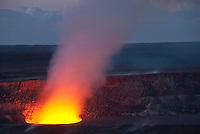 Pele's cauldron of lava glowing red at Halema'uma'u crater, Kilauea Volcano, Hawai'i Volcanoes National Park, Big Island of Hawai'i.