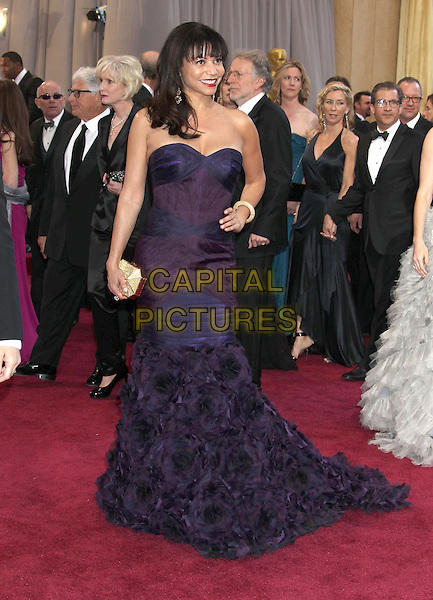 Gloria Reuben.85th Annual Academy Awards held at the Dolby Theatre at Hollywood & Highland Center, Hollywood, California, USA..February 24th, 2013.oscars full length strapless dress hand on hip purple feathers fishtail corsage .CAP/ADM/RE.©Russ Elliot/AdMedia/Capital Pictures.