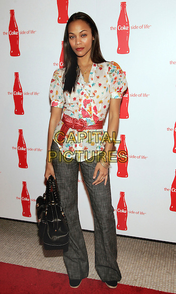 "ZOE SALDANA.at Coca-Cola's ""Coke Side Of Life"" Launch Party with a Performance by Ne-Yo at Capitale, New York, NY, USA,.30 March 2006..Full length red waist belt printed shirt.Ref: ADM/JL.www.capitalpictures.com.sales@capitalpictures.com.©AdMedia/Capital Pictures."