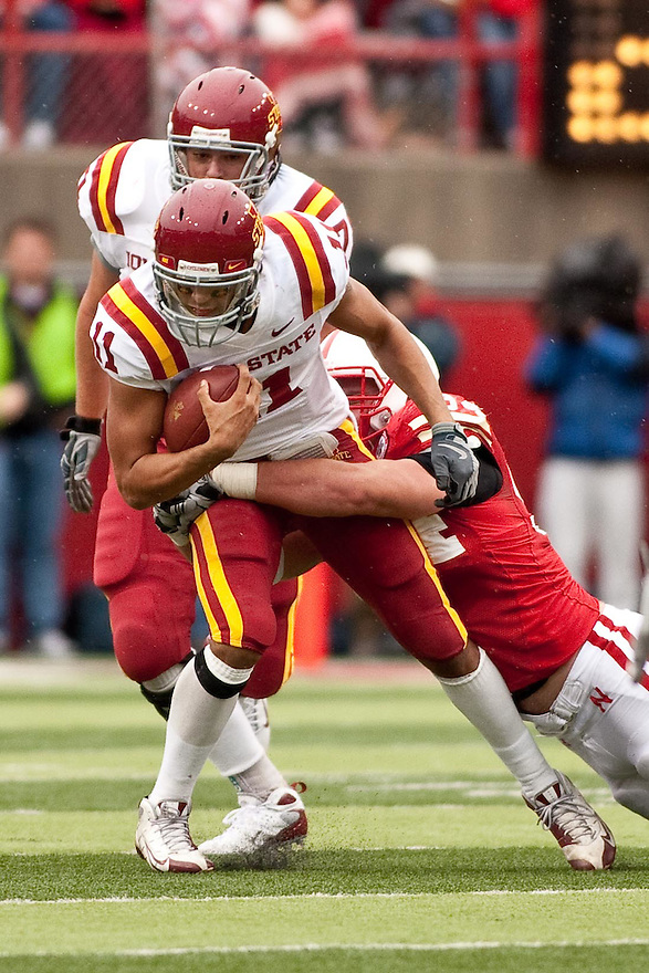 24 October 2009: Iowa State quarterback Jerome Tiller being tackled by Nebraska defensive tackle Jared Crick at Memorial Stadium, Lincoln, Nebraska. Iowa State defeats Nebraska 9 to 7.