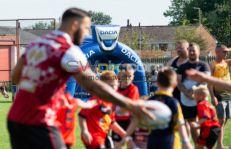 Picture by Allan McKenzie/SWpix.com - 25/07/2018 - Rugby League - Dacia Flair Play - New Spring Lions & Ince Rose Bridge RLFC, Ince-in-Makerfield, England - Romain Navarrete with some of the younger age groups, Dacia, branding.