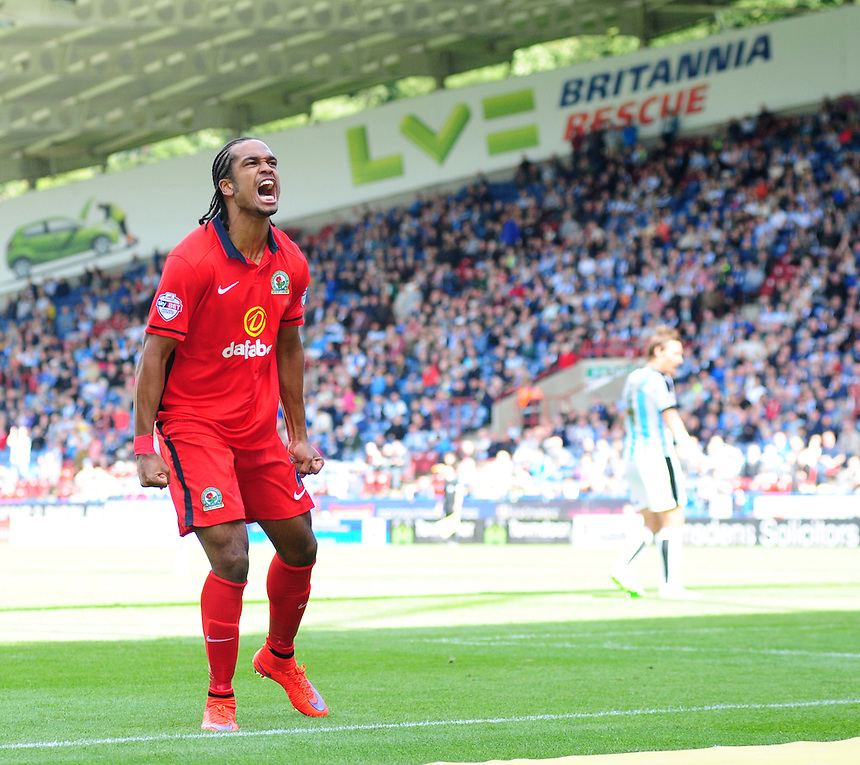 Blackburn Rovers' Nathan Delfouneso celebrates scoring his sides equalising goal to make the score 1-1<br /> <br /> Photographer Chris Vaughan/CameraSport<br /> <br /> Football - The Football League Sky Bet Championship - Huddersfield Town v Blackburn Rovers - Saturday 15th August 2015 - The John Smith's Stadium - Huddersfield<br /> <br /> &copy; CameraSport - 43 Linden Ave. Countesthorpe. Leicester. England. LE8 5PG - Tel: +44 (0) 116 277 4147 - admin@camerasport.com - www.camerasport.com