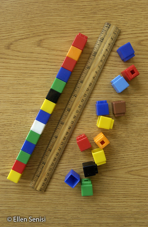 Schenectady, NY.Unix cubes and ruler on school desk..Unix cubes (which come in different colors and snap together) are used in a variety of ways as a hands-on, kinesthetic way to reinforce basic concepts in elementary level math lessons..©Ellen B. Senisi