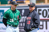 Great Lakes Loons coach Seth Conner (16) and pitching coach Bobby Cuellar (19) talk in the outfield prior to a Midwest League game against the Wisconsin Timber Rattlers on May 12, 2018 at Fox Cities Stadium in Appleton, Wisconsin. Wisconsin defeated Great Lakes 3-1. (Brad Krause/Four Seam Images)