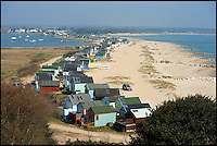 BNPS.co.uk (01202 558833)<br /> Picture: PeterWillows/BNPS<br /> <br /> The train carries passengers from the car park to the middle of Mudeford Spit, pictured, a pedestrian-only beach to the east of Hengistbury Head. <br /> <br /> There was outrage today after a family that has run one of Britain's first 'Noddy' land trains for 46 years were served with a notice to quit the service.<br /> <br /> The much-loved novelty train that carries people to a remote beach was started in 1968 by the late Roger Faris, who hand-built the carriages himself.<br /> <br /> Since his death 34 years ago his widow Joyce, 88, has operated the independent service for 364 days a year and runs it more as a hobby than a profitable business.<br /> <br /> The little train has been used by generations of people and become a popular fixture at the Hengistbury Head beauty spot in Dorset.<br /> <br /> Now after five decades of service, town hall officials have told Mrs Faris they will not be renewing their contract with her as they intend to operate their own train service.
