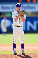 Relief pitcher Joe Goodman #33 of the High Point Panthers looks to his catcher for the sign against the Dayton Flyers at Willard Stadium on February 26, 2012 in High Point, North Carolina.    (Brian Westerholt / Four Seam Images)