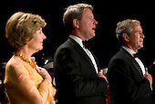 26 April 2008 - Washington, D.C. - First Lady Laura Bush, David Westin and President George W. Bush stand at the head table during the 2008 White House Correspondents Association Dinner. Photo Credit: Kristoffer Tripplaar/ Sipa Press