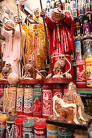Candles, magical potions, and Santa Muerte figurines for sale in the market, city of Veracruz, Mexico