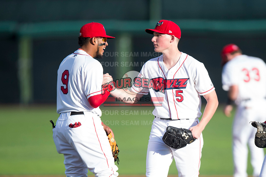Orem Owlz third baseman Kevin Maitan (9) wishes good luck to starting pitcher John Swanda (5) before a Pioneer League game against the Ogden Raptors at Home of the OWLZ on August 24, 2018 in Orem, Utah. The Ogden Raptors defeated the Orem Owlz by a score of 13-5. (Zachary Lucy/Four Seam Images)