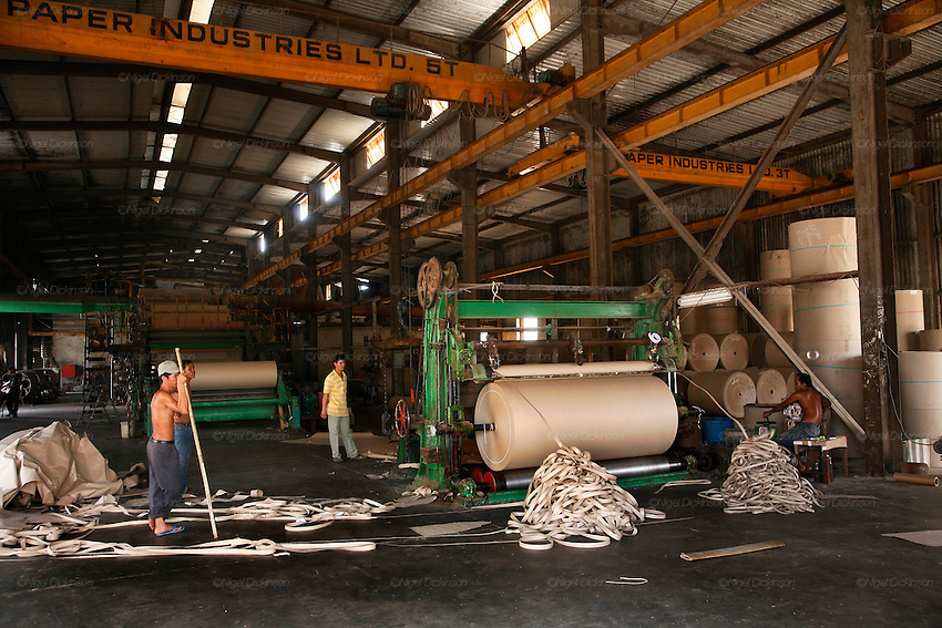 Rolls of paper are cut down to size to the exact dimensions required by box making factories. The waste is just recycled back into the system. Recycling factory for cardboard and waste paper on the outskirts of Phnom Penh. This is the biggest recycling factory for cardboard in Cambodia. The paper is mixed with water, into mulch, then the sticky mixture is laid up a belt which goes through various drying and cleaning procedures. The end product, a grey coloured paper is used primarily in corrugated cardboard filling. However most of the carboard is exported to Thailand and Vietnam