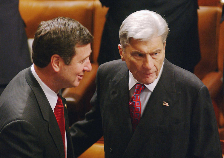 1/28/03.STATE OF THE UNION ADDRESS--Sen. George F. Allen, R-Va., and Sen. John W. Warner, R-Va., talk before President George W. Bush's State of the Union address at the U.S. Capitol..CONGRESSIONAL QUARTERLY PHOTO BY SCOTT J. FERRELL