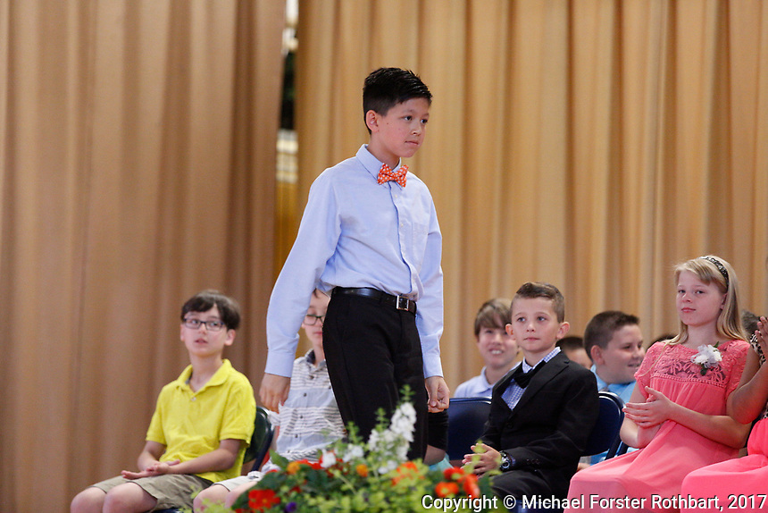 The Oneonta Greater Plains elementary school fifth grade awards ceremony, on June 21, 2017.<br /> &copy; Michael Forster Rothbart Photography<br /> www.mfrphoto.org &bull; 607-267-4893<br /> 34 Spruce St, Oneonta, NY 13820<br /> 86 Three Mile Pond Rd, Vassalboro, ME 04989<br /> info@mfrphoto.org<br /> Photo by: Michael Forster Rothbart<br /> Date:  6/21/2017<br /> File#:  Canon &mdash; Canon EOS 5D Mark III digital camera frame C19187