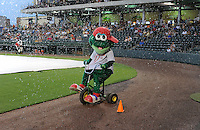Greenville Drive mascot Reedy Rip'It is showered with water as he rides a bike during a lengthy rain delay before a game against the on July 5, 2012, at Fluor Field at the West End in Greenville, South Carolina. The game eventually was postponed due to rain. (Tom Priddy/Four Seam Images)