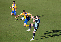 Ryan Tafazolli of Mansfield Town beats Paul Hayes of Wycombe Wanderers to the ball during the Sky Bet League 2 match between Wycombe Wanderers and Mansfield Town at Adams Park, High Wycombe, England on 25 March 2016. Photo by Andy Rowland.