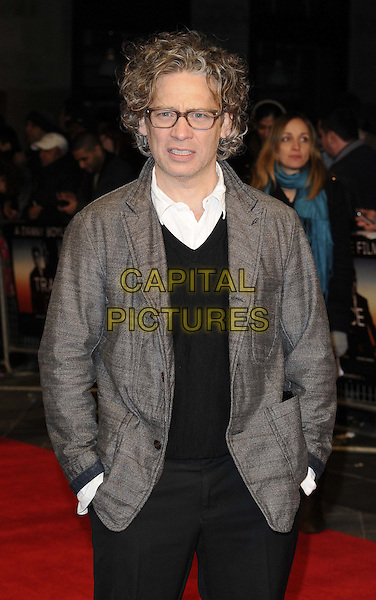 Dexter Fletcher.'Trance' World premiere held at Odeon West End, London, England..19th March 2013.half length white grey gray jacket black top hands in pockets glasses .CAP/CAN.©Can Nguyen/Capital Pictures.