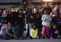 """NWA Democrat-Gazette/CHARLIE KAIJO Kids collect candy as a parade goes by, Saturday, November 30, 2019 during an annual Christmas parade along Emma Ave. in Springdale.<br /> <br /> Floats, bands and Santa greeted visitors for the 23rd annual Christmas parade. This year's theme was """"Christmas Vacation"""". The parade started at Parsons Stadium and headed west on Emma Avenue, concluding at Harris Street."""
