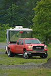 Red Chevy dually towing horse trailer