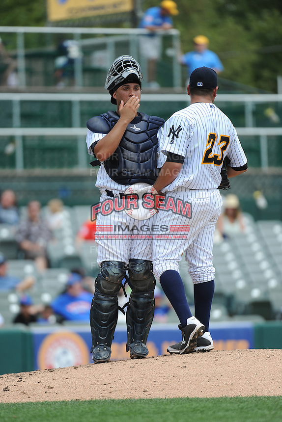Trenton Thunder catcher Francisco Arcia (16) and pitcher Manny Banuelos (23) during game against the Binghamton Mets at ARM & HAMMER Park on July 27, 2014 in Trenton, NJ.  Trenton defeated Binghamton 7-3.  (Tomasso DeRosa/Four Seam Images)