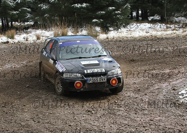 Calum Strachun - Leslie Craib in a Mitsubishi Evolution 4 at Junction 6 on Special Stage 1 Riccarton on the Brick & Steel Border Counties Rally 2014, Round 2 of the RAC MSA Scottish Rally Championship sponsored by ARR Craib Transport Limited and other championships  and organised by Whickham & District and Hawick & Border Car Clubs and based in Jedburgh and held in Kielder Forest on 22.3.14.