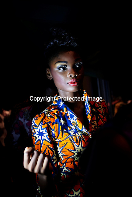 ABUJA, NIGERIA MAY 26: Fifteen year old model Favour Lucky waits backstage before a fashion show launching ECOWAS fashion week on May 26, 2013 in Abuja, Nigeria. Nigerian and invited African designers showcased their collections during one night only show. Favour won Nigeria's next supermodel when she was fourteen years old. (Photo by: Per-Anders Pettersson)