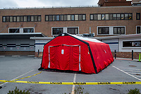 A drive-through COVID-19 testing tent is seen in parking lot outside Carney Hospital in Dorchester, Massachusetts, on Mon., March 23, 2020. Earlier this week, it was announced that Carney Hospital would be the United States first dedicated patient ward for Coronavirus (COVID-19) treatment.
