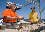 Jack and Anne Rudloe look over a sea creature on their boat in the Gulf of Mexico as they collect specimens for their Gulf Specimen Marine Lab in Panacea, Florida Florida May 27, 2009.  (Mark Wallheiser/TallahasseeStock.com)