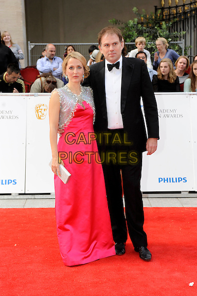 GILLIAN ANDERSON & MARK GRIFFITHS.The Philips British Academy Television Awards, Grosvenor house Hotel, Park Lane, London, England, UK..May 22nd 2011.arrivals TV Baftas Bafta full length couple pink red dress silver cape beaded jacket long maxi black tuxedo tux bow tie clutch bag .CAP/DH.©David Hitchens/Capital Pictures.