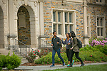Students walk to and from class past the Old Chemistry Building through the Academic Quad on a beautiful Spring morning.