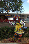 Free standing painting of Calico the Clown and Cat in front of the elementary school in Lake Placid