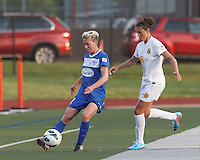 Boston Breakers midfielder Joanna Lohman (11) passes the ball as Western New York Flash midfielder Carli Lloyd (10) defends. In a National Women's Soccer League Elite (NWSL) match, the Boston Breakers (blue) tied Western New York Flash (white), 2-2, at Dilboy Stadium on June 5, 2013.
