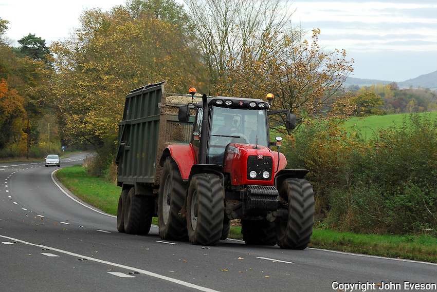 Tractor carting forage maize on the road. A49, Cheshire....Copyright John Eveson 01995 61280..j.r.eveson@btinternet.com