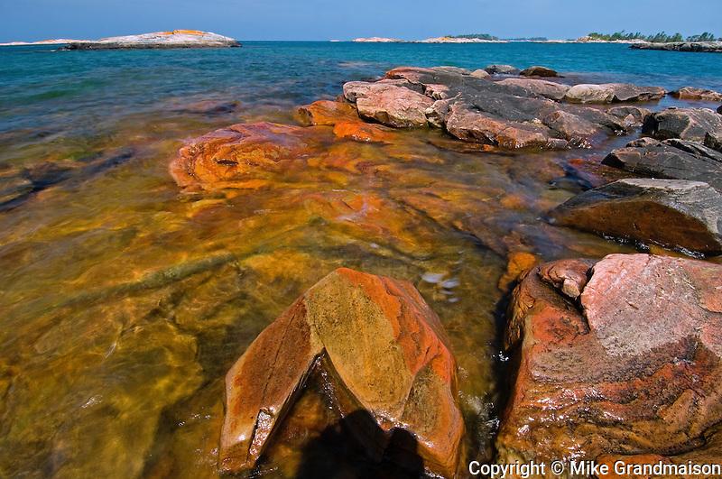 Rocks on shoreline of Windsor Island in Georgian Bay of Lake Huron<br /> near Snug Harbour<br /> Ontario<br /> Canada
