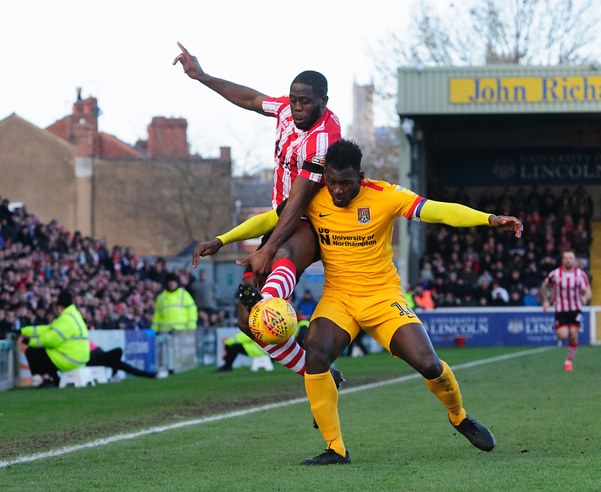 Lincoln City's John Akinde vies for possession with Northampton Town's Aaron Pierre<br /> <br /> Photographer Chris Vaughan/CameraSport<br /> <br /> The EFL Sky Bet League Two - Lincoln City v Northampton Town - Saturday 9th February 2019 - Sincil Bank - Lincoln<br /> <br /> World Copyright © 2019 CameraSport. All rights reserved. 43 Linden Ave. Countesthorpe. Leicester. England. LE8 5PG - Tel: +44 (0) 116 277 4147 - admin@camerasport.com - www.camerasport.com