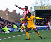 Lincoln City's John Akinde vies for possession with Northampton Town's Aaron Pierre<br /> <br /> Photographer Chris Vaughan/CameraSport<br /> <br /> The EFL Sky Bet League Two - Lincoln City v Northampton Town - Saturday 9th February 2019 - Sincil Bank - Lincoln<br /> <br /> World Copyright &copy; 2019 CameraSport. All rights reserved. 43 Linden Ave. Countesthorpe. Leicester. England. LE8 5PG - Tel: +44 (0) 116 277 4147 - admin@camerasport.com - www.camerasport.com