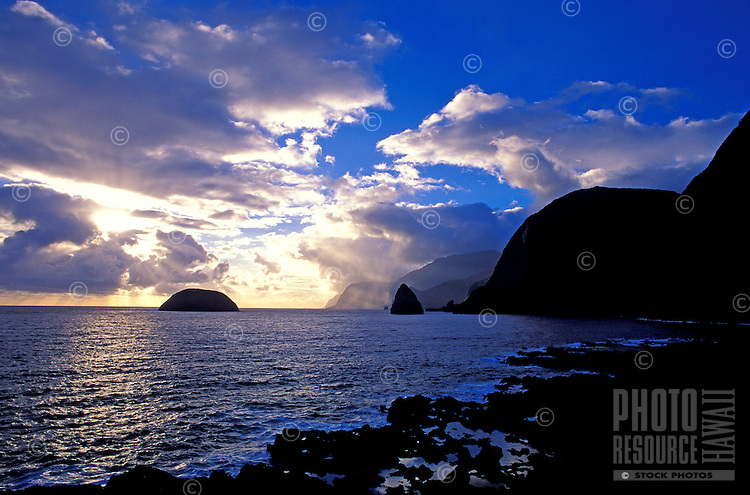 Sunrise along the coastline of the Kalawao area, on the Kalaupapa peninsula, with Mokapu Island (left) and Okala Island (right) in the background