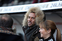 SWANSEA, WALES - FEBRUARY 07: Wayne Routledge of Swansea watches on from the stand during the Premier League match between Swansea City and Sunderland AFC at Liberty Stadium on February 7, 2015 in Swansea, Wales.