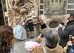Valencia-Spain, January 14, 2018; <br /> children in traditional, local costume pose for parents at the rococo style - alabaster entrance of the González Martí National Museum of Ceramics and Decorative Arts; <br /> Photo © HorstWagner.eu