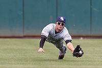 New Orleans Zephyrs center fielder Jake Marisnick (28) makes a diving catch during the Pacific League game at the Chickasaw Bricktown Ballpark against the Oklahoma City RedHawks on April 13, 2014 in Oklahoma City, Oklahoma.  The RedHawks defeated the Zephyrs 4-3.  (William Purnell/Four Seam Images)