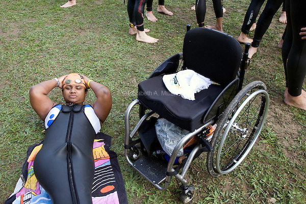 Minda's rests in her parawetsuit before the start of the New Jersey Devilman Triathlon on May 5, 2012 in Cumberland County, New Jersey.