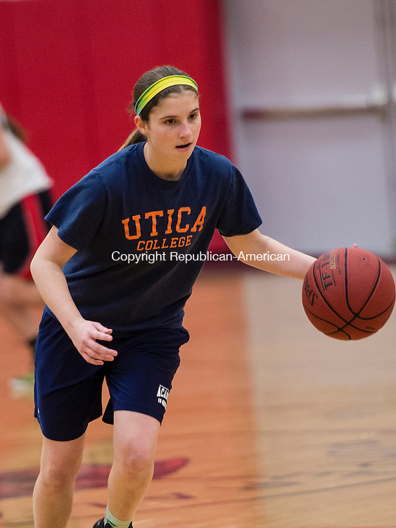 THOMASTON, CT- 30 November 2015-113015EC26-   Pomperaug's Lauren Rubinstein dribbles during a drill. Monday was the first day of practice for the Panthers. Erin Covey Republican-American