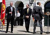 United States President Barack Obama (R), Vice President Joe Biden (L) and Secretary of Veterans Affairs Robert McDonald (C) attend the Wounded Warrior Ride event at the White House, in Washington, DC, April 14, 2016.  The event helps raise awareness to the public about severely injured veterans and provides rehabilitation opportunities. <br /> Credit: Aude Guerrucci / Pool via CNP
