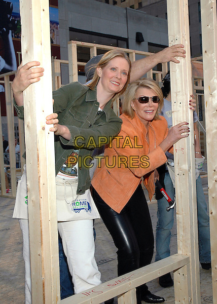 CYNTHIA NIXON & JOAN RIVERS.Pitches in with other volunteers at the Habitat For Humanity Project on the NBC Today Show in Rockefeller Plaza, New York, New York..September 28th, 2005.Photo Credit: Patti Ouderkirk/AdMedia/Capital Pictures.Ref: PO/ADM.full length green jacket orange jacket hammers black leather trousers sunglasses shades.www.capitalpictures.com.sales@capitalpictures.com.© Capital Pictures.